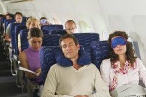 Germany, Munich, Bavaria, Passengers sleeping in economy class airliner